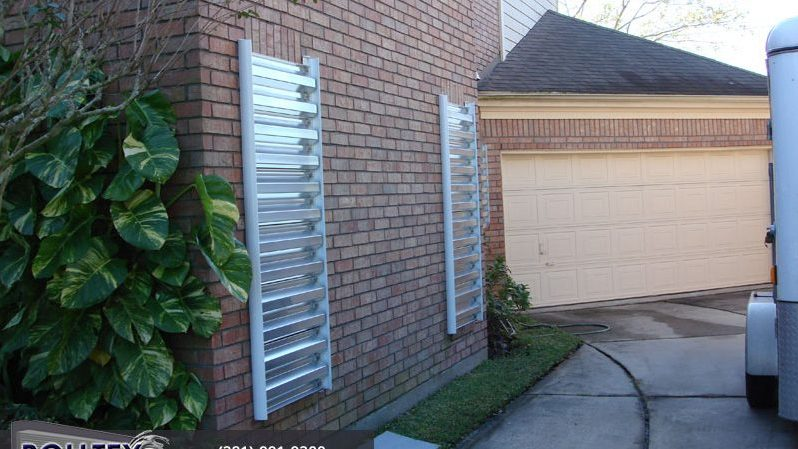 small hurricane panels by the garage